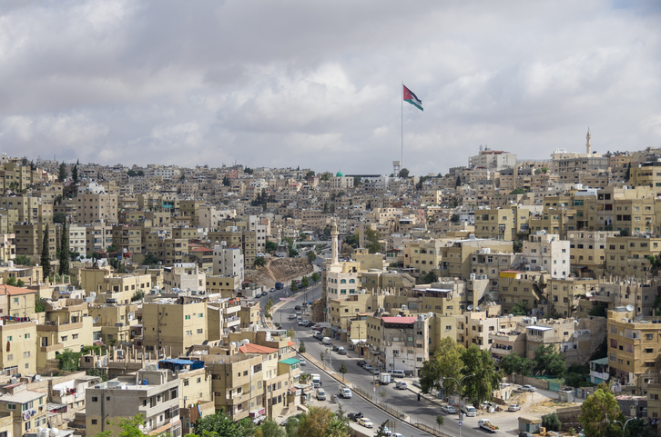 Amman city view with big Jordan flag and flagpole, Amman